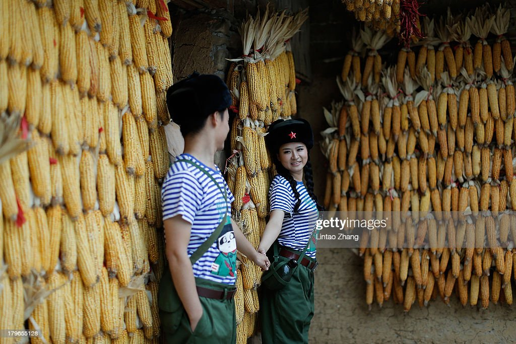 A young couple dressed as 'young pioneers' for their wedding pictures are seen in the Zhangjiajie national park on September 1 2013 in Zhangjiajie...
