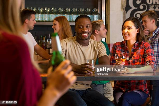 Young Couple drinking in a Bar