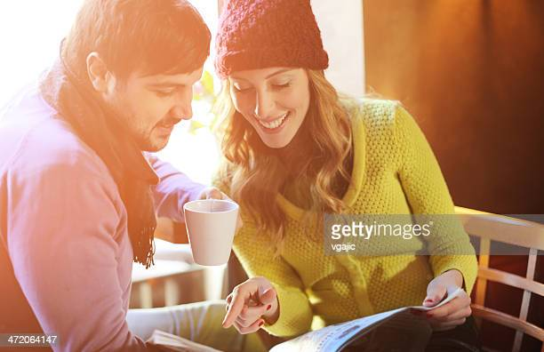 Young Couple Drinking Tea Indoors.