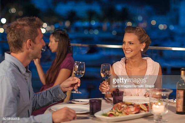 Young couple drinking white wine in restaurant, Dubrovnik, Croatia