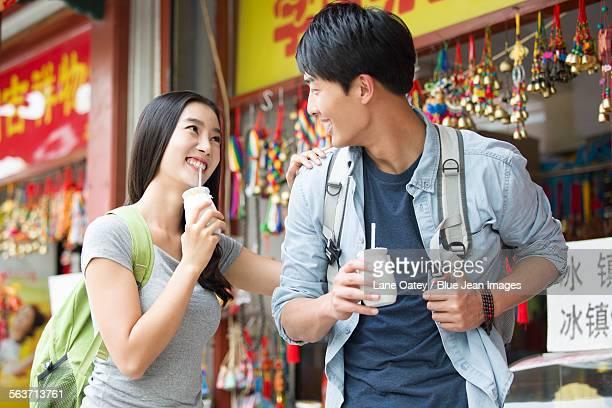 Young couple drinking yogurt