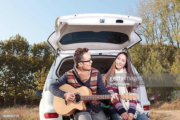 Young couple driving to play