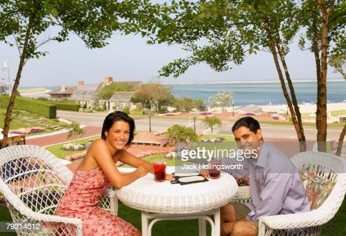 Young couple eating at beach resort : Stock Photo