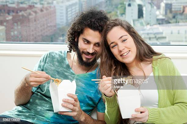 Young couple eating Chinese Cuisine