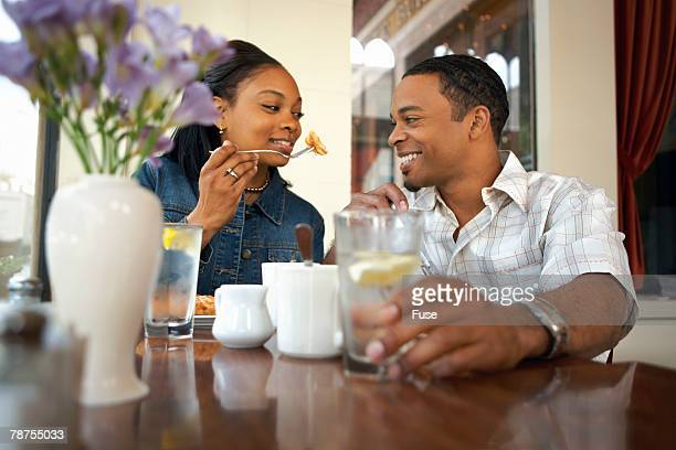 Young Couple Eating Meal
