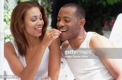 Young couple eating : Stock Photo