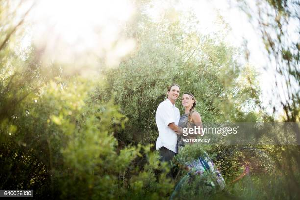 Young couple embrace after engagement