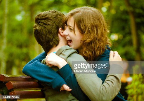 Young couple embracing and laughing : Stock Photo