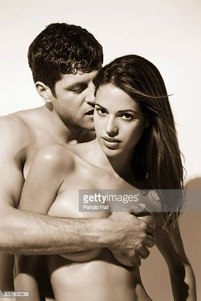 Young Couple embracing, bare-chested, portrait
