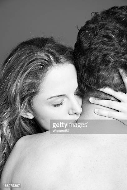 Young couple embracing, close-up