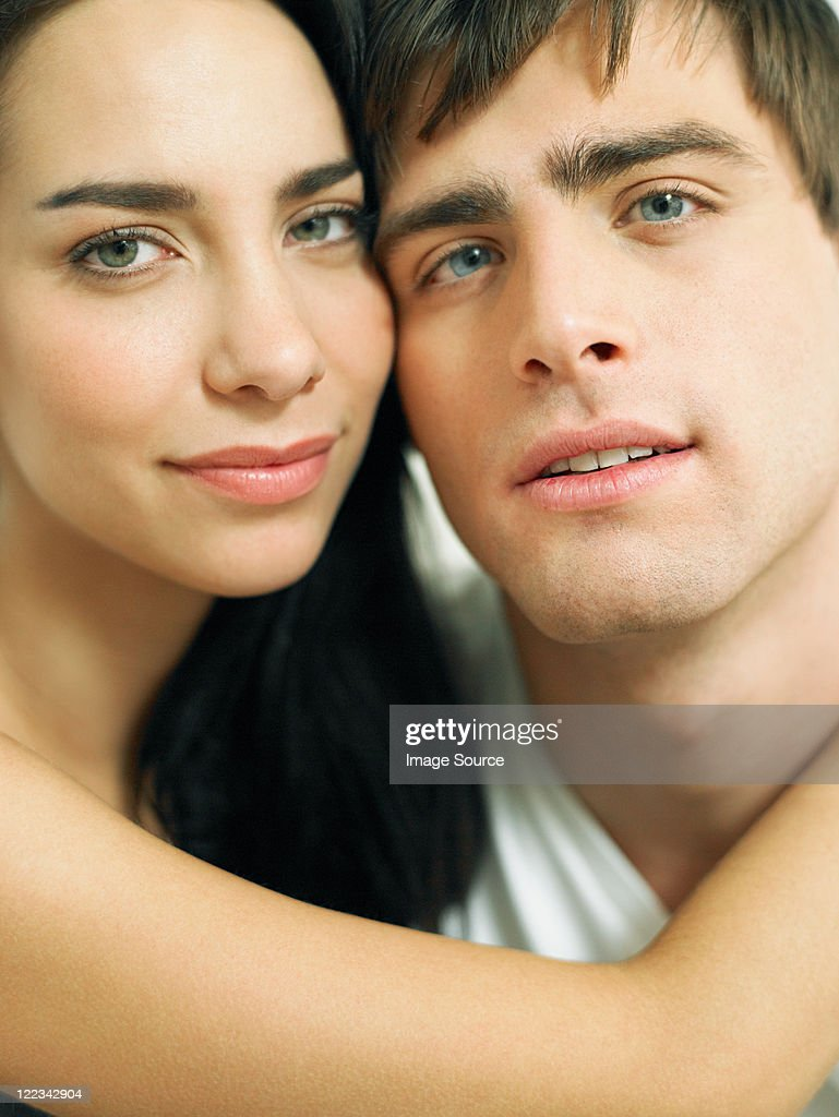Young couple embracing close-up, portrait : Stock Photo