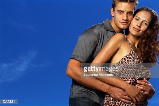 Young couple embracing, portrait : Stock Photo
