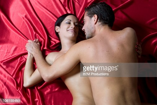 Young couple engaged in sexual intercourse : Stock Photo