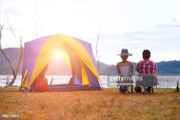 Young couple enjoy Camping Outdoors , sky clear in background. Holiday , vacation , summer concept