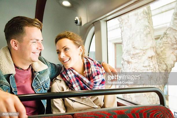 Young couple enjoying a bus ride in London