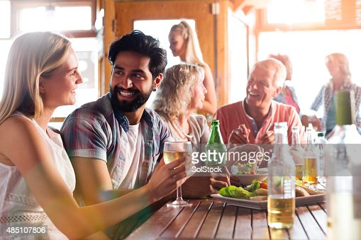 Young Couple Enjoying a Meal and a Drink
