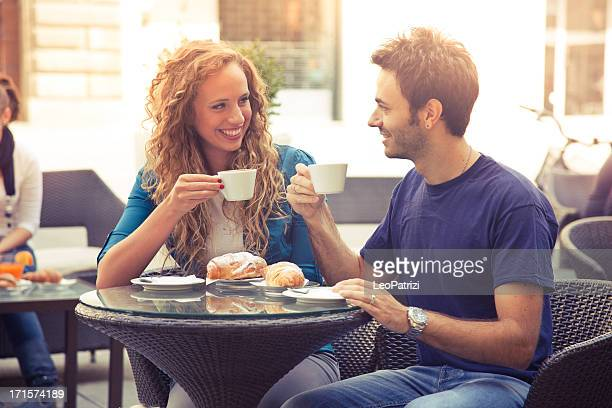 Young couple enjoying breakfast in cafe
