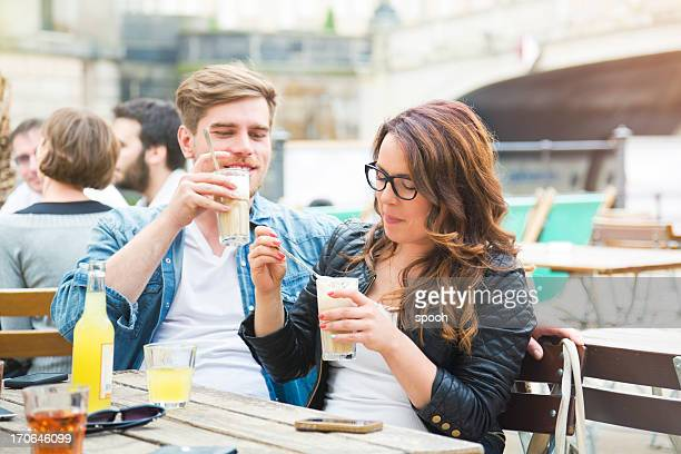 Young couple enjoying coffee.