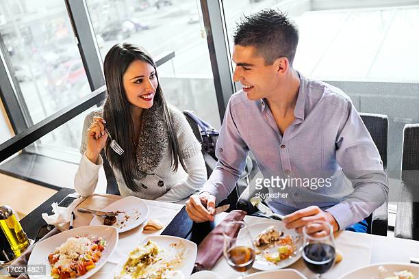 Young couple enjoying in a restaurant.