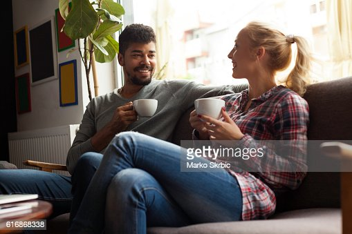 Young couple enjoying in the coffee shop : Stock Photo