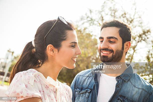 Young couple enjoying life outdoor in a city park