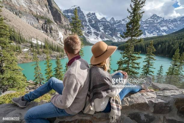 Young couple enjoying mountain lake scenery