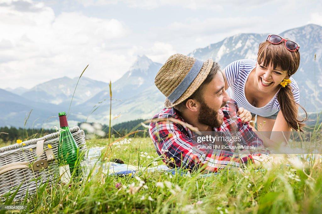 Young couple enjoying picnic together, Tyrol, Austria