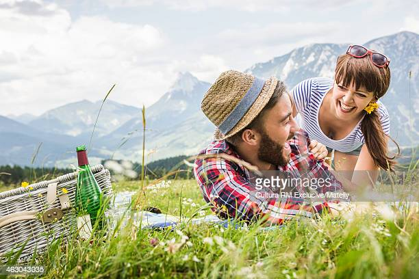 Young couple enjoying picnic together, Tyrol, Austria