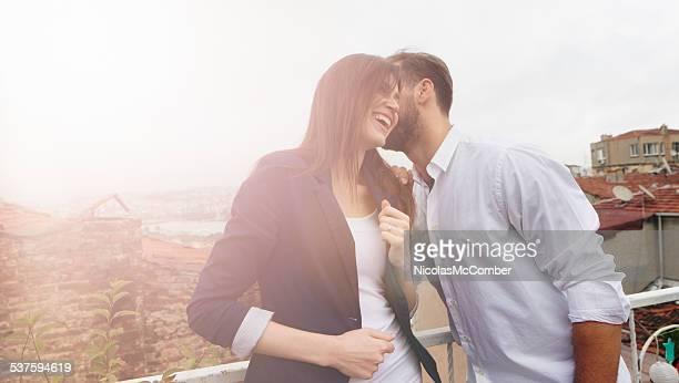 Young couple enjoying rooftop romance