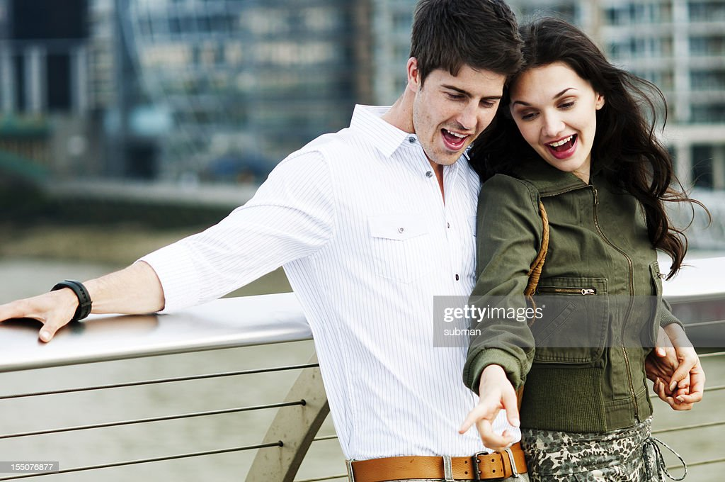 Young couple enjoying the outdoors of citylife : Stock Photo