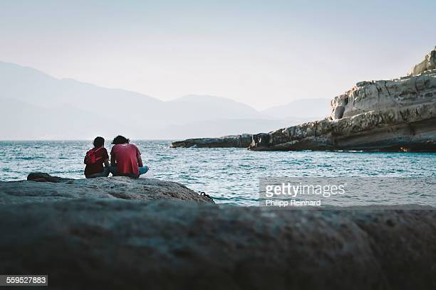 Young couple enjoys the landscape at sea