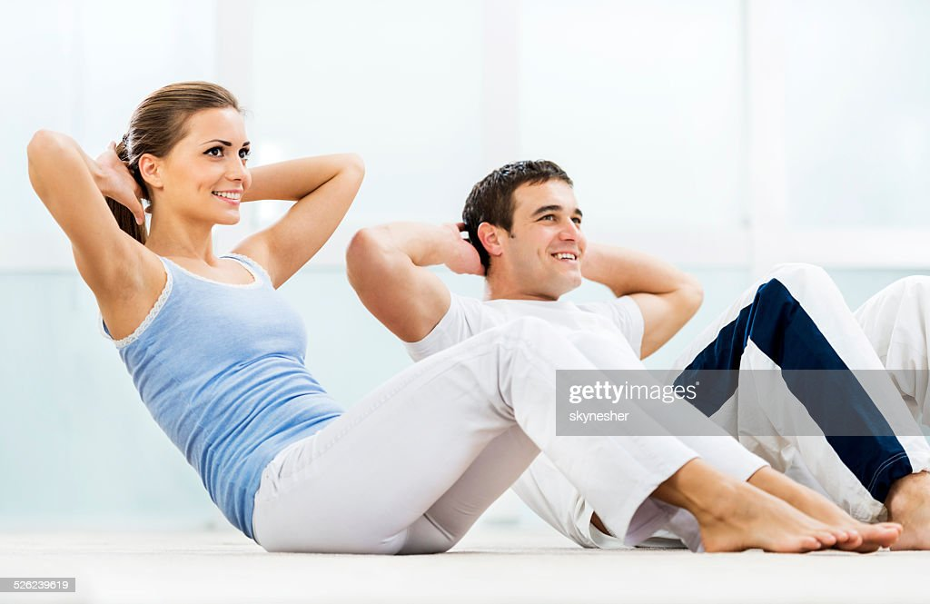 Young couple exercising. : Stock Photo