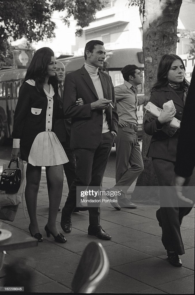 A young couple fashionably dressed photographed while strolling along a treelined avenue in one of the more modern quarters of Jerusalem where a...