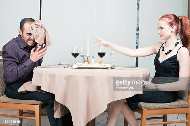 Young couple fighting during a meal