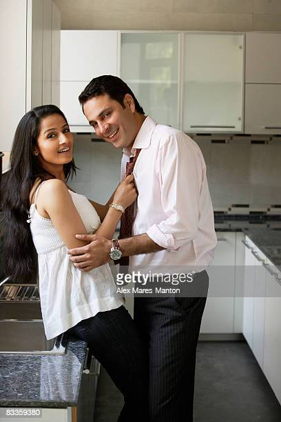 young couple flirting in kitchen