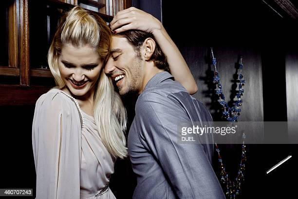 Young couple flirting in nightclub