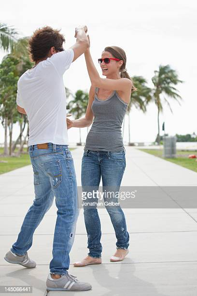Young couple flirting on the promenade