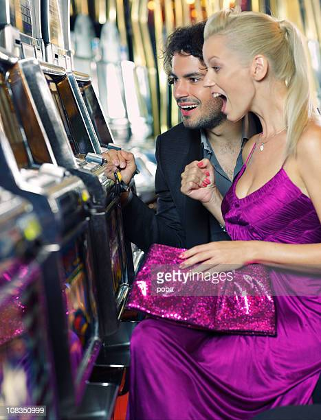 young couple gambling in the casino