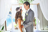 Young couple getting married at wedding alter