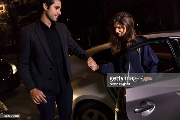 Young couple getting out of car at night