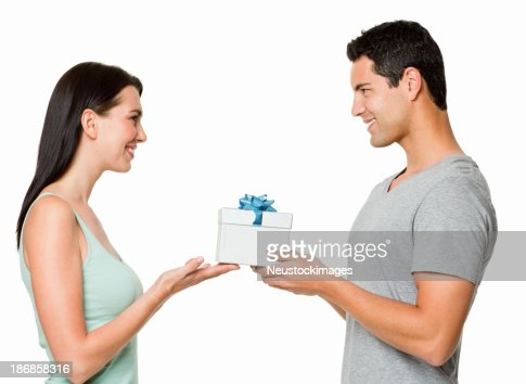 Young Couple Giving a Gift - Isolated