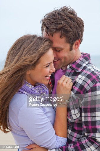 Young couple hanging out on the beach : Stock Photo