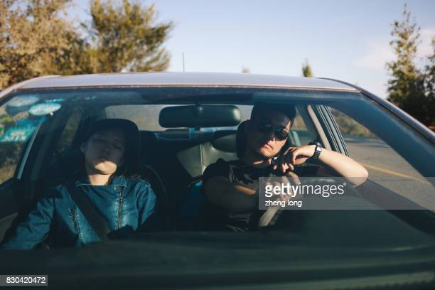 young couple have rest on the roadside