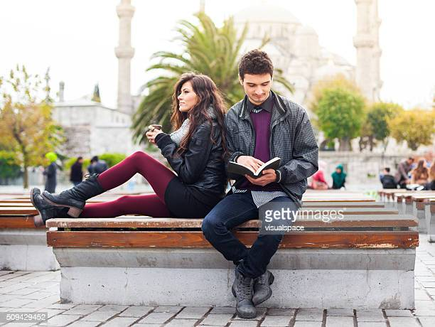Young Couple Having A Break Outside The Blue Mosque