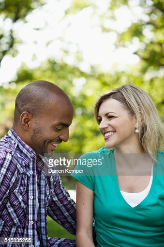 Young couple having a chat in a park : Stock-Foto
