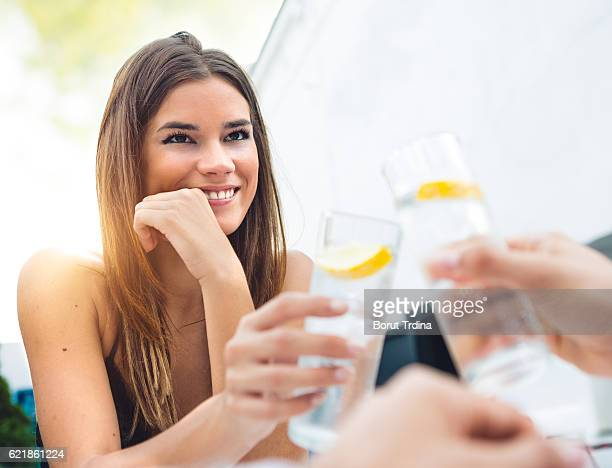 Young Couple Having A Drink In The Bar