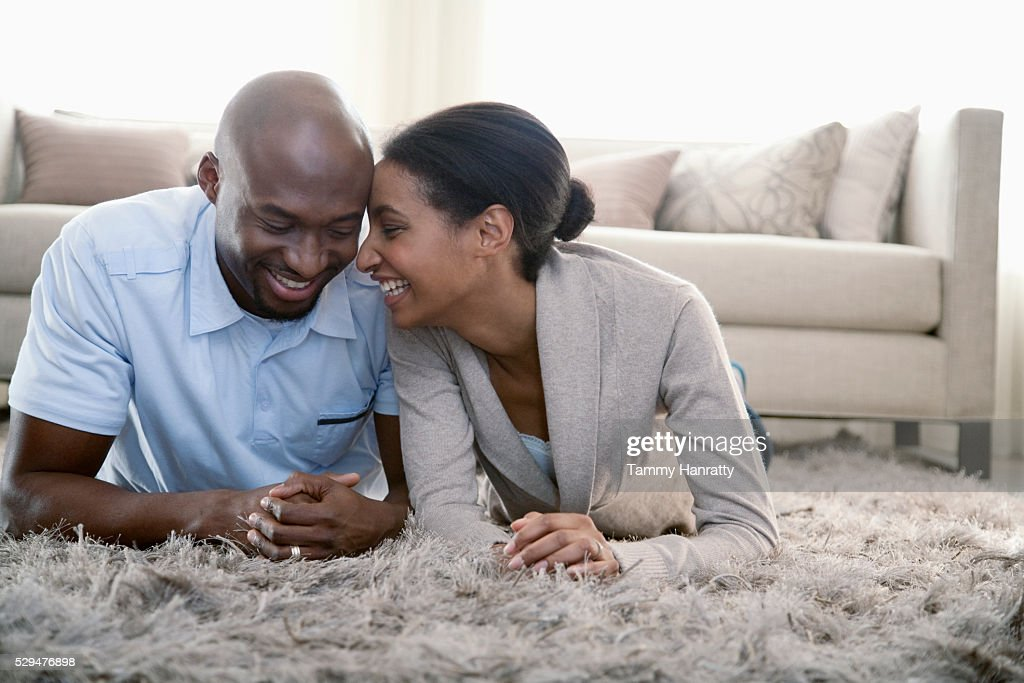 Young couple having a quiet, relaxing moment on the floor : Stock Photo