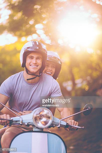 Young couple having a road trip together on their scooter