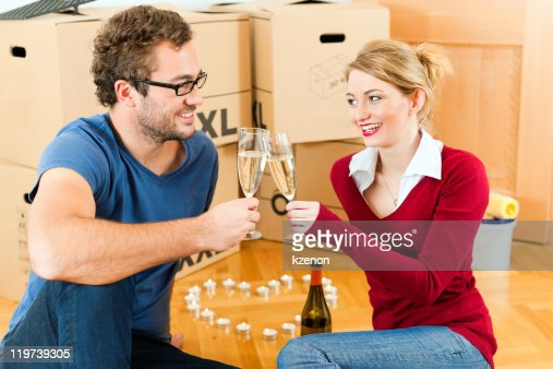 Young couple having break while moving in : Stock Photo