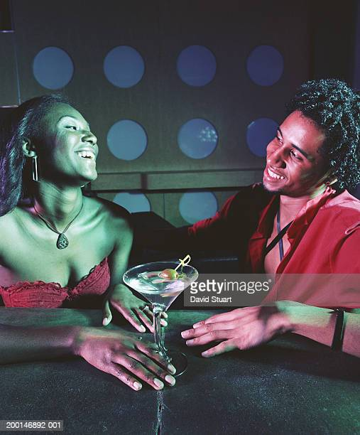 Young couple having cocktails at nightclub